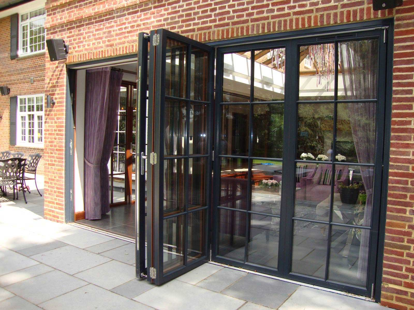 many people prefer to opt for aluminium bi fold door frames because aluminium will not twist or decay through ageing or when exposed to weathering elements